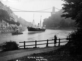 A steamer with a steam tug under Clifton Suspension Bridge.