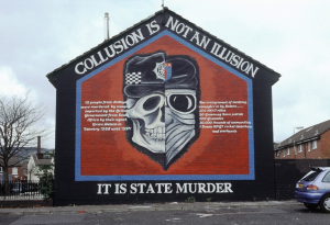 Republican mural explaining collusion between Force Research Unit operatives and the Ulster Defence Regiment
