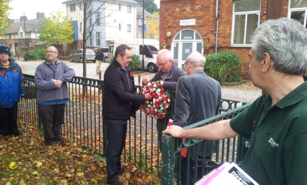 David Jeffries and members of the Remembering the Real WWI Group attaching the wreath to the railings at Dings Park.